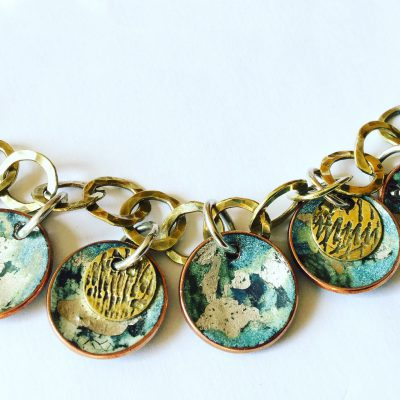 Small vitreous enamel disks with silver, copper and brass chain