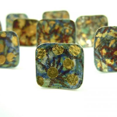 small silver studs with vitreous enamel and gold leaf